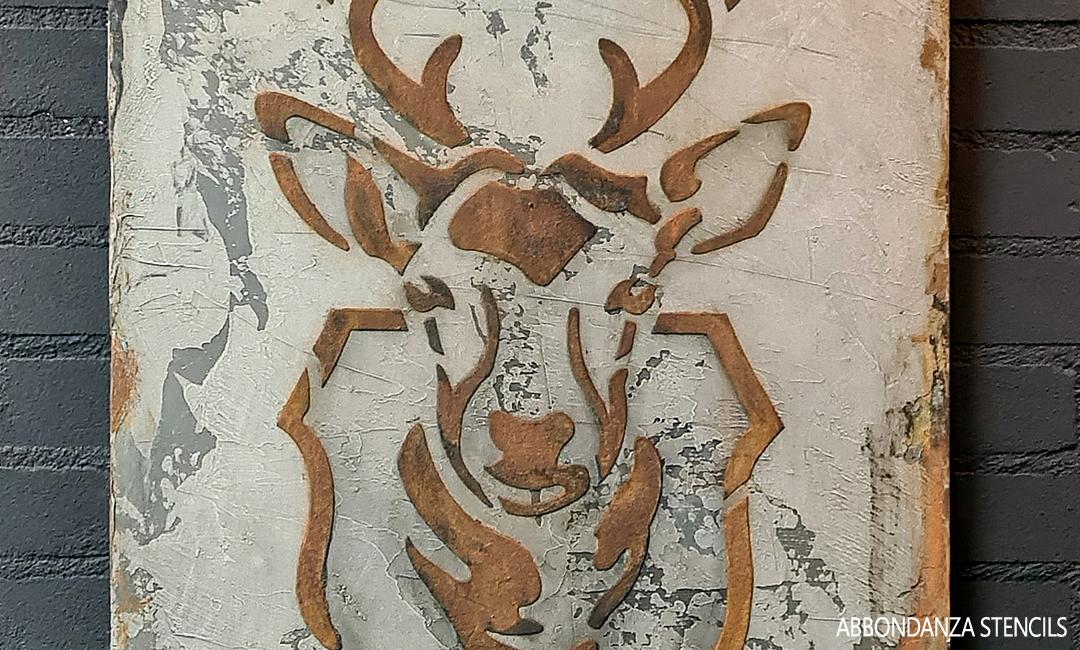Wandbord met een stencil in betonlook en roest